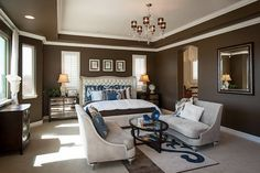 Dark Wall Colors in Modern Master Bedroom  Love the paint job!