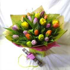 A multi coloured Tulip handtie bouquet, gift wrapped and presented in a flower bag. Flower Bag, Tulips, Bouquet, Presents, Gift Wrapping, Seasons, Flowers, Gifts, Color