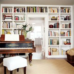 IDEA FOR FRONT ROOM - with pocket doors.  MUST BE STYLED = NO CLUTTER A LA 10 CHESTERFIELDS    Doorway Savvy  – Built-in bookshelves surrounding a doorway can be tricky; start by filling the top row with books.  – Alternate the remaining nooks with creatively stacked books and combinations of books and accessories.  – Layer a few small pieces of art in the back of the shelves to give them depth.