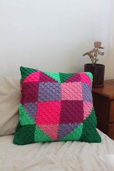 'Hug' is a c2c cushion cover that uses Paintbox yarns.Bright and modern, and a perfect gift to remind your loved ones that you are thinking of them! Find this lovely pattern and more Valentine's Day inspiration at LoveKnitting.Com.