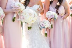 pure lavish events | st. regis monarch beach | blush and white wedding | luxury wedding | black tux | bride and groom | grand staircase | florals by Jenny | kaysha weiner photography | wedding bouquets | champagne