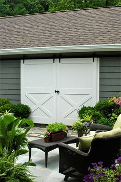 Sliding Barn Doors would be great as outdoor shutters on art studio window by street