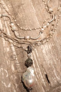 Jill Duzan — Pearls and Curls - There's just something feminine about pearls and this one is no exception. Texture and whimsy define A202 with a little nod to sophistication. Wear it alone or paired with the hand tied pearl (MP39) and a large pearl drop (AP03). We're also showing our silver Navajo chain if you really like to layer yourself up! It's YOUR style