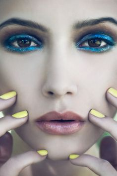 Love yellow nail polish! Gorgeous blue liner too...