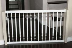 For wide door frames, use the side rail of an old crib for a more stylish pet gate