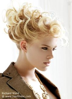 Updo with curls and all hair away from the face http://www.hairfinder.com/richardward/metrochic3.htm