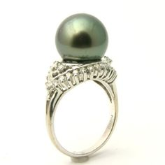 White Tahitian Black Pearl & Diamond Engagement Ring - A brilliant color combination on the shank & on the pearl itself comes this White Tahitian Black Pearl & Diamond Engagement Ring stamped in 18k White Gold featuring a Mystic Topaz Cultured Pearl set on the top of the ring surrounded by additional White Round accent stones on the top & sides of the custom gold shank. This White Tahitian Pearl ring is 11.8mm in diameter & the total gem weight is equal to .67 carats. #unusualengagementrings