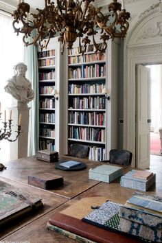 Paris Apartment...love the boxes on the table…
