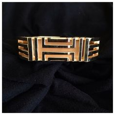 "Gold Tory burch Fitbit flex braclet In good condition has some small scratches just normal wear. Transform your Fitbit into a super-chic accessory with Tory Burch's caged metal bangle that conveniently carries your Fitbit Flex®. Work to weekend, day to night, this open fretwork bracelet looks polished while keeping your tracker close at hand. Gold-tone or silver-tone plated brass/resin Imported 2.5"" diameter; 0.6"" width Box-and-tab hinge closure with button release Fits the Fitbit Flex® with…"