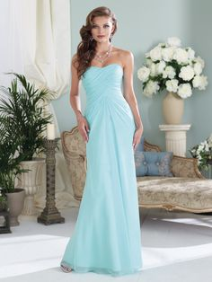 Strapless chiffon slim A-line gown with softly curved neckline, asymmetrically draped empire bodice with corset back, center front draped skirt, suitable as a bridesmaid dress or an evening gown. Removable straps included. (No longer available in color shown).  Available in all chiffon colors. Sizes: 0 – 28