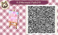 A mermaid themed pastel brick path that I made, with music notes, starfish, and seashell designs on the bricks and a bow shaped brick just for fun :3