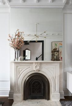 simple mantel styling with large mirror // Christine Dovey