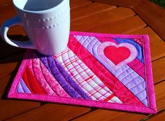 Valentine Mug Rug: appliqué hearts, red and purple snack mat, scrappy purple and pink candle mat, quilted mini placemat, Valentine décor by TeriMadeIt on Etsy https://www.etsy.com/listing/494507092/valentine-mug-rug-applique-hearts-red