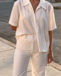 cd9b64bba Clean cut and simple pairing of a white shirt and white linen trousers.  Vita Jeans
