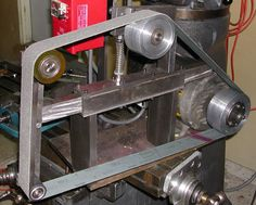 Belt Grinder by kenny -- Homemade belt grinder constructed from an electric motor and pulleys. Utilizes a commercial sanding belt. http://www.homemadetools.net/homemade-belt-grinder-20