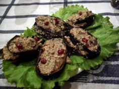 Badrijani (nigvzit--with nuts): marinaded eggplant topped with walnut sauce