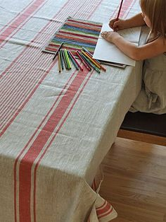 Red Linen Provence Tablecloth Red stripes over natural grey colour shade backround. This wonderful mix of red and natural linen colours produces a French-style tablecloth, ideal for both formal and in