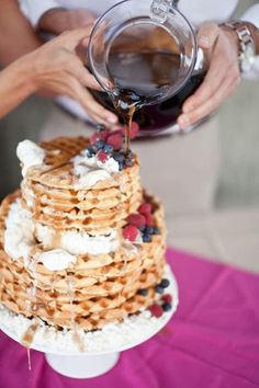 My cousin got married last year and at the reception they had a really delightful breakfast-for-lunch affair, with a giant griddle and a jolly chef flipping pancakes dramatically. I thought of that wedding when I spotted this charming waffle cake — hello, wedding brunch! What do you think of waffles, instead of cake?
