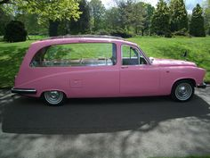 pink hearse and here's the car to deliver me and my pink casket