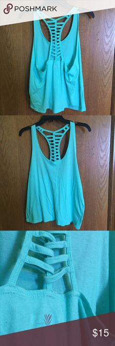 Racerback Workout Top Super cute workout top with back detail. Soft cotton material. Lighting makes it look brighter in pictures, the last photo is the most accurate. Size L From F21 so it fits like a M/L. Good condition. Forever 21 Tops