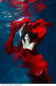 Girl in red gown underwater