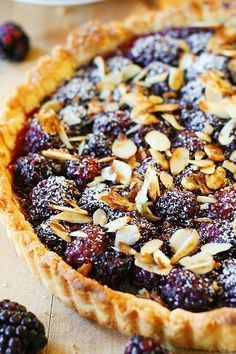Blackberry tart topped with toasted almonds - this French style dessert is made completely from scratch, in a homemade tart crust! This blackberry tart is all about the Summer, and a great way to use Summer Dessert Recipes, Just Desserts, Delicious Desserts, Sweet Pie, Sweet Tarts, Blackberry Tart Recipes, Dessert Crepes, Funnel Cakes, Popsicle Recipes