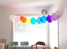 Display a bright rainbow of balloons floating in mid-air