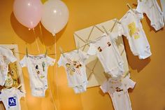 a southern baby shower-the game was to design the baby's favorite onsie and create it using fabric and glue!! :)
