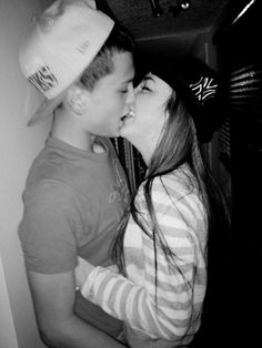 smiling while kissing