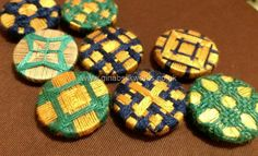 A variety of thread wrapped and woven passementerie button by Gina Barrett. Trials, worked in cotton thread,
