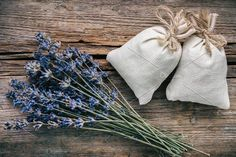 #Lavender flowers and sachets  Bouquet of dry lavender flowers and sachets filled with dried lavender. Top view. Flat lay. Retro toned.