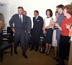 KN-C28773 29 May 1963 White House staff celebrate President John F. Kennedy's birthday with JFK and Jacqueline Kennedy in the Navy Mess Hall. Photograph by Robert Knudsen in the John F. Kennedy Presidential Library and Museum, Boston.