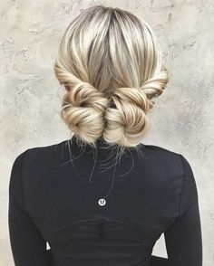 We are loving this casual cute twisted back bun style! Double your fun with 2 buns and an elegant swept back feel. Part hair in the middle, twist both sections back and secure with an elastic. twist each ponytail into a full bun and pin to secure. Spray hair with a bit of Big Sexy Hair Push Up to add texture and fullness before you style! https://www.sexyhair.com/push-up-dry-thickening-spray.html
