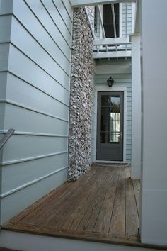 Idea for my future beach house: chimney stack covered in oystershells