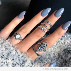 Gray oval shape nails with midi rings and furry coat for winter, LOVE!