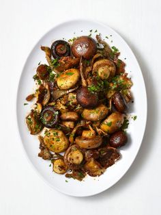 Smoky Roasted Whole Mushrooms, from Food Network. Corrie's Notes: I just did the oven roasting part, and they were fantastic. (Put mushrooms in a cast iron skillet, drizzle with oil, and roast at 425 degrees for 30 minutes, stirring every 10 minutes)