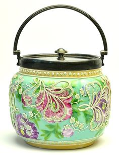 A Japanese Nippon Moriage Biscuit Jar, the moriage slip decorated jar with electroplated nickel silver lid and rim with marks for James Dixon  Sons