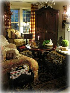 Love the warmth this room exudes, the colors and the furniture placement.   So, so cozy.