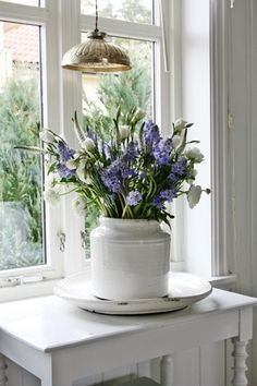 purple flower in a white vase ❥ re pinned by www.huttonandhutton.co.uk