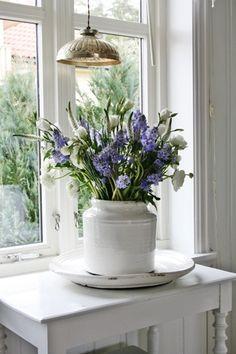 purple flower in a white vase ❥ re pinned by www.huttonandhutton.co.uk