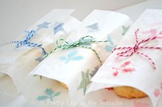 Create your own pretty wax paper packaging for edible gifts. Bright colored punched paper pieces between two sheets of wax paper and ironed to seal. It's that easy.