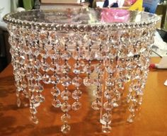 Chandelier cake stand ! How Beautiful !!  Glue chandelier beads to your cake stand and glue clear rhinestone trim around the top.
