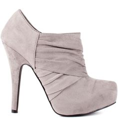 Try your luck in the Gambol by G by Guess.  This adorable ankle bootie features wrapped a ruched grey fabric through the vamp and upper.  A 1 inch hidden platform is featured and a 5 inch stiletto heel.