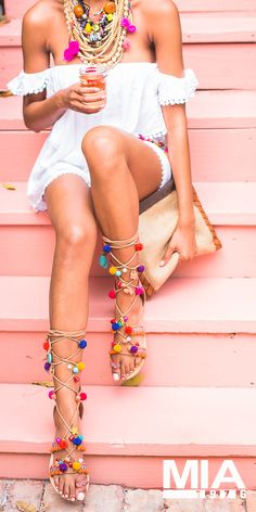 The MIA Reanna Pom-Pom Gladiator is adorned with pom-poms, charms and more. Click the pic to shop #MIAShoes