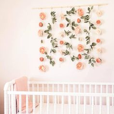 This GORGEOUS felt flower wall hanging is the perfect addition to any baby girl nursery, first birthday backdrop or even your wedding! Its completely custom so you can have it fit your color palette for your special event or room. PRODUCT DETAILS These backdrops have hand made felt