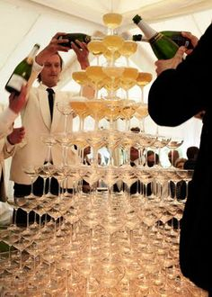 The champagne tower at Kate Moss' #wedding makes us want to have one too. Right now.