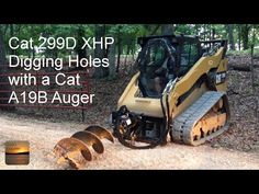 Cat 299D XHP Digging Holes with a Cat A19B Auger - YouTube