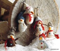 Delightful felted wool snowmen frolic outside a snowy village. Each has cute…