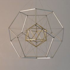 """Dodecahedron with Icosahedron Suspended Inside 13"""" x 13"""" x 13"""" brass and aluminum tubing and steel wire 2008"""
