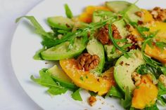 We love seeing new flavor combinations with fresh avocado. Here's a simple salad with Mango, avocado, and arugula and pecans by Nava at Veg Kitchen